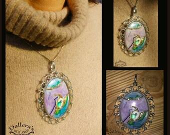 Silver and ceramic pendant.
