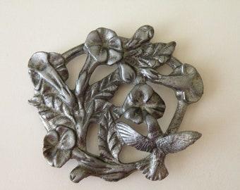 Metzke Pewter floral Hummingbird Trivet, jar top, lid, wall hanger, paperweight.