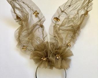 Gold mesh bunny ears headband.