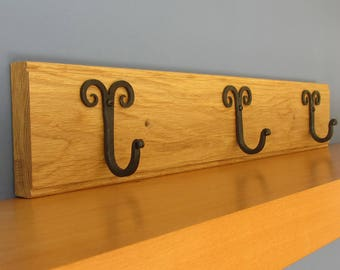 Coat hooks artisan hand forged iron coat hooks on oak rail