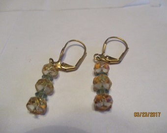 dangle earrings, gold and green crystal, gold tone lever back wires.