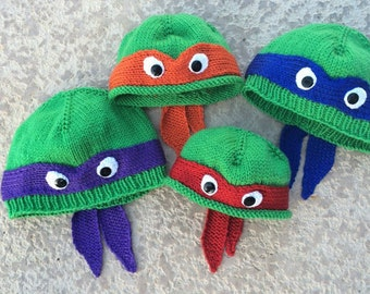 Hand-knit teenage mutant ninja turtle hat with ribbed or rolled bottom edge.  COWABUNGA!
