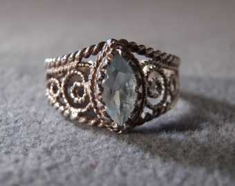 vintage sterling silver fashion ring with large marquise shaped blue topaz ring with rope designed scroll work, size 8