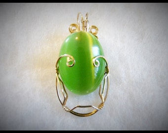 A very unique wire wrapped interchangeable stone pendant.