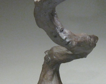 Reach / Clay Figurative Sculpture with Faces and a Teacup / Valerie Gilman / Taproot Arts and Insight