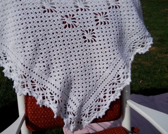 Lacy white baby afghan