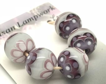 Lampwork bead set in purple, lilac and grey.