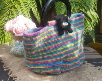 Rainbow striped Crocheted Sausage Cats handbag, with knitted Cat fastener.