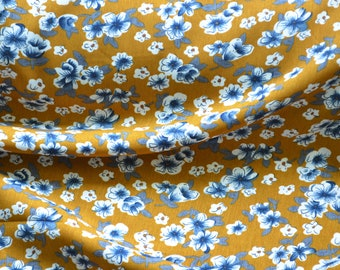 Rayon Crepe fabric 100% Viscose with a great lightweight drape. Floral fabric with yellow, blue and white colors.  Purchase by 1/2 meter