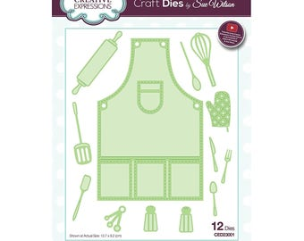 Sue Wilson Dies ~ Necessities Collection CHOOSE ONE: Apron CED23001; Baked with Love CED23002