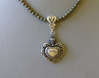 Antique style heart pendant.