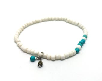 White anklet with turquoise and pendant