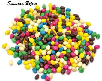 100 oval 6 x 4 mm wooden beads.