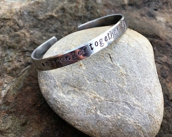 Hand Stamped '#strongertogether' cuff bracelet. Proceeds to Planned Parenthood. Hillary Clinton, hashtag strongertogether, nasty women.