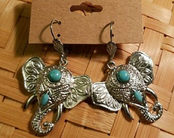Antique Silver Elephant dangling earrings. Mounted turquoise color stones.  Light weight. Hollow inside..Metal Not heavy.