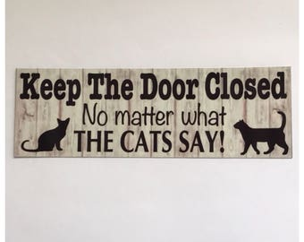 Cat Sign - Keep The Door Closed No Matter What The Cat's Say Meow Paw Pet