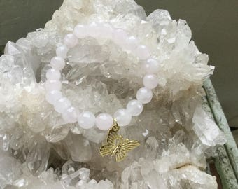 Love transforms All ~  rose quartz stretch bracelet with butterfly charm