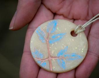Glittery Pastel Blue and Pink Leaf Imprint Round Pendant Hemp Necklace