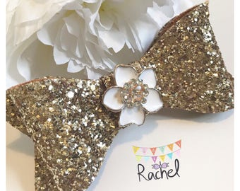 Gold Glitter Statement Bow with Flower Embellishment