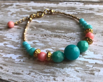 Aqua and coral pink bracelet eith gold accents