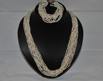 Beautiful Multi Strand Baroque Pearl Necklace And Matching Bracelet Set, With Silver Clasps