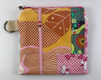 Pieced fabric larger coin purses with tiny buttons