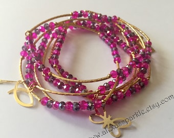 Pink and Purple crystal beaded charm bracelet set with gold plated charms- Semanario pulseras color rosas y purpuras con dijes chapa de oro