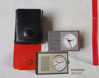 NEPRO Swiss Made Nepro transistorized alarm in steel tone with black leather case.