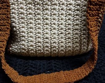 Crocheted purse with leather trim