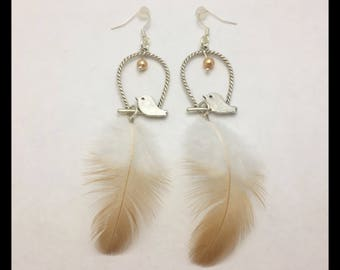Earrings natural feathers, prints and glass beads