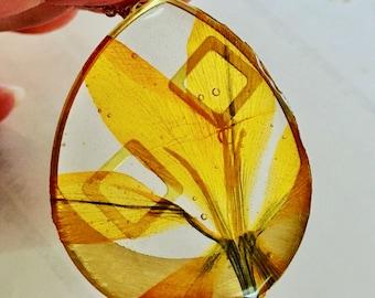 Crocus flower and brass inset teardrop necklace