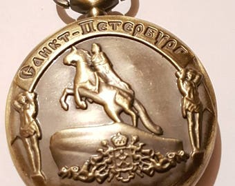 Bronze  pocket watch with horse and rider. Pocket watch with bronze metal chain