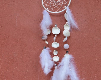 White dream catcher with shells
