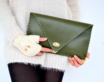 Dark green leather clutch