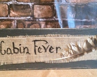 Cabin fever sign with real feather