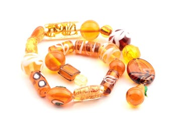 Lot (21) Vintage Czech foil lined feather marble overlay fruit topaz lampwork glass beads