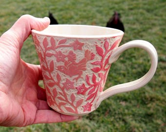 Large Cup, White with Orange and Red Hand Carved birds and flowers
