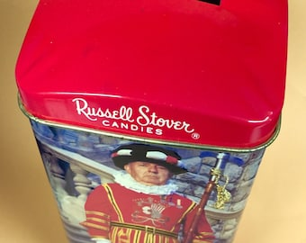 Russell Stover Candies Tin Bank Featuring Beefeater / Held English Caramels