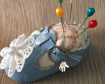 Blue baby shoe pin cushion