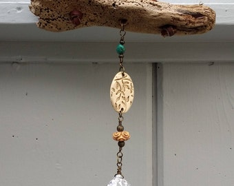 Driftwood sun-catcher with beaded accents