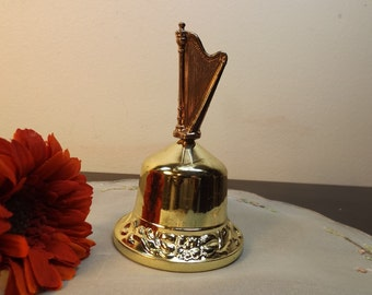 "Gold tone bell with charming rose above. Beautiful home decor in excellent condition.Gift for her. 3 1/4""H ."