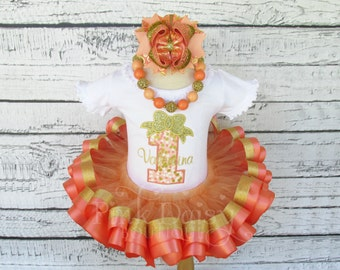 Girls Peach, Coral, and Gold Satin Ribbon Trim Tutu Birthday Outfit with Matching Stacked Boutique Bow and Chunky Necklace.