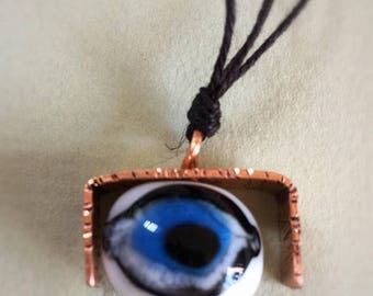 On sale -30% Glass eyeball in copper pendant