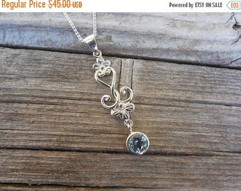 ON SALE Beautiful blue topaz flower necklace handmade in sterling silver