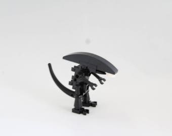 Alien minifigure made out of LEGO® bricks