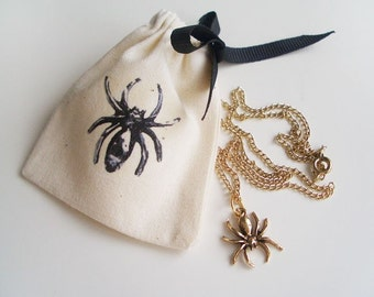 """Mini spider gold necklace (16"""") with matching pouch"""