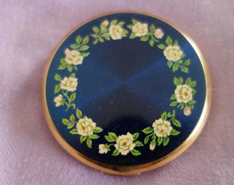 Very Pretty Stratton powder compact with floral design