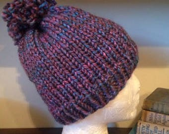 Purple and blue knit hat with pom pom