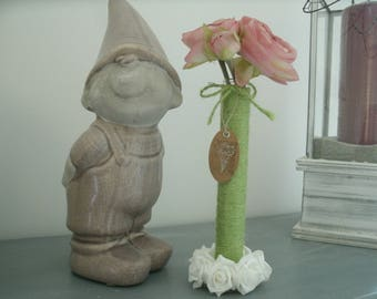 vase with test tube, dark green burlap and white flowers