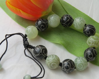 beautiful etched, adjustable Chinese jade bracelet.